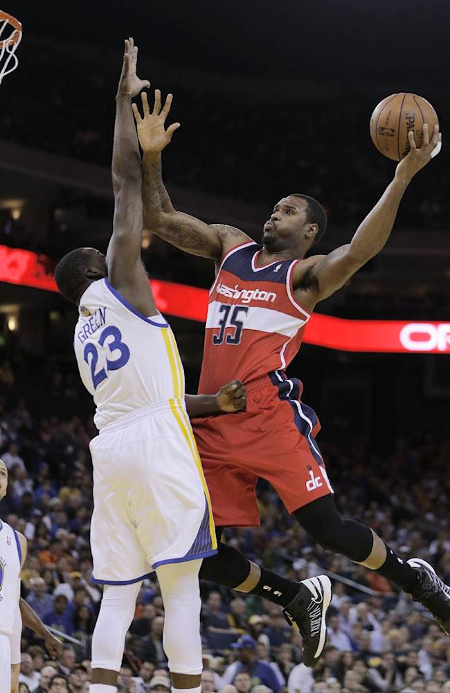 Washington Wizards' Trevor Booker, right, shoots over Golden State Warriors' Draymond Green (23) during the first half of an NBA basketball game, Tuesday, Jan. 28, 2014, in Oakland, Calif