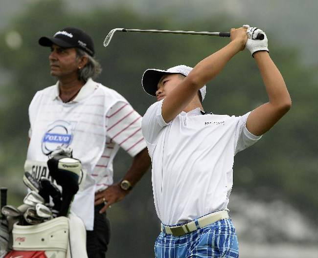 In this photo released by OneAsia,  Guan Tianlang of China plays a shot during the second round of the Volvo China Open at Genzon Golf Club in Shenzhen, southern China Friday, April 25, 2014.  Fifteen-year-old Guan, a year removed from his breakout performance at the Masters, failed to make the cut at the China Open on Friday, shooting a 76 to finish at 3-over 147