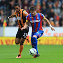 Hull City's Ahmed Elmohamady, left, and Crystal Palace's Joel Ward battle for the ball during their English Premier League soccer match at the KC Stadium, Hull, England, Saturday, Oct. 4, 2014