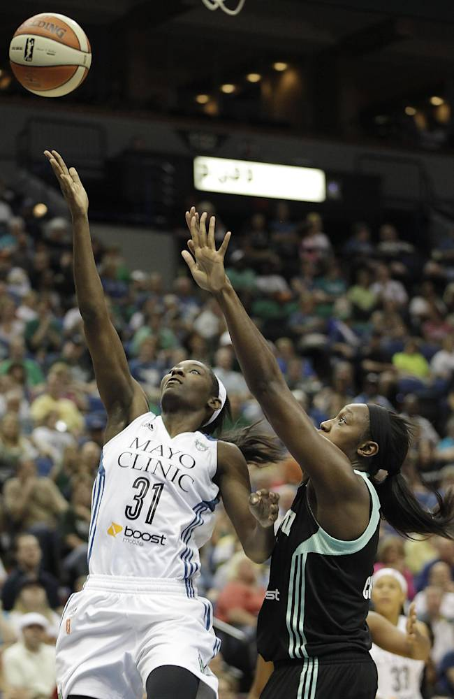 Minnesota Lynx forward Asia Taylor (31) goes up to the basket against New York Liberty center Tina Charles (31) during the second half of a WNBA basketball game, Saturday, May 24, 2014, in Minneapolis. The Lynx won 87-82