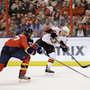 Ottawa Senators left wing Clarke MacArthur (16) passes past Florida Panthers defenseman Tom Gilbert (77) during the first period of an NHL hockey game, Tuesday, March 25, 2014 in Sunrise, Fla The Associated Press