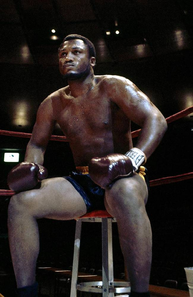 In this undated photo, Joe Frazier sits in the corner of a ring. Frazier died Nov. 7, 2011, after a brief battle with liver cancer at the age of 67. Philadelphia sculptor Stephen Lane has been commissioned to make a statue to be erected at an entertainment complex near city's three sports stadiums and close to the now-demolished Spectrum, an arena where he fought. The original sculptor assigned to the task, Lawrence J. Nowlan, died in August 2013