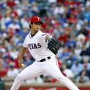 Texas Rangers starting pitcher Yu Darvish (11), of Japan, throws to the Oakland Athletics during the first inning of a baseball game, Tuesday, May 21, 2013, in Arlington, Texas. (AP Photo/Jim Cowsert)