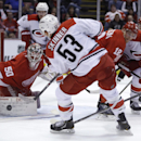 Carolina Hurricanes left wing Jeff Skinner (53) shoots the puck towards Detroit Red Wings goalie Jonas Gustavsson (50) of Sweden during the first period of an NHL hockey game in Detroit, Thursday, Nov. 21, 2013 The Associated Press