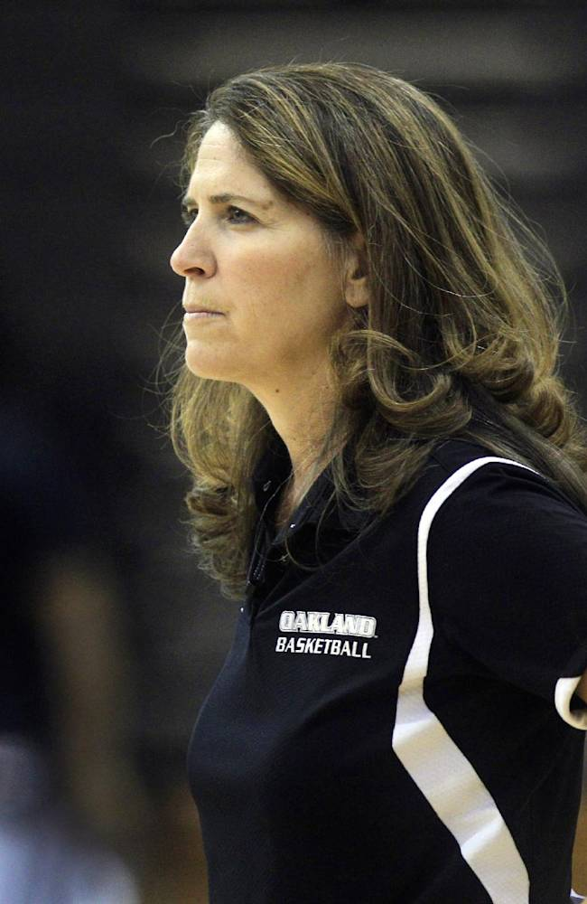 In this Oct. 16, 2012, file photo, Oakland University women's basketball coach Beckie Francis watches her team' practice in Rochester Hills, Mich. Oakland University's former women's basketball coach says she's trying to grasp why the school fired her. She was fired by the 19,000-student school June 12. Oakland say Francis physically and emotionally abused players, obsessed about their weight and pushed Christian beliefs on them