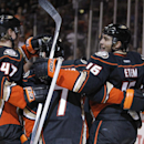 Anaheim Ducks defenseman Hampus Lindholm (47), of Sweden, and center Andrew Cogliano (7) celebrate a goal by right wing Emerson Etem (16) during the second period of a preseason NHL hockey game against the Los Angeles Kings, Sunday, Sept. 28, 2014, in Ana