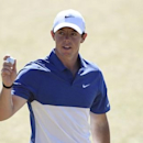 Jun 21, 2015; University Place, WA, USA; Rory McIlroy waves to the crowd after putting on the 18th green in the final round of the 2015 U.S. Open golf tournament at Chambers Bay. Kyle Terada-USA TODAY Sports