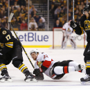 Ottawa Senators' Erik Condra (22) gets dumped by Boston Bruins defenseman Torey Krug (47) as Bruins' Milan Lucic (17) takes control of the puck during the first period of an NHL hockey game in Boston, Saturday, Dec. 13, 2014 The Associated Press