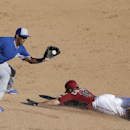 Kansas City Royals second baseman Jimmy Paredes makes the catch but applies the tag too late as Arizona Diamondbacks' Tony Campana slides in safely to second during the eighth inning of an exhibition spring training baseball game Wednesday, March 5, 2014,