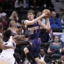 Phoenix Suns guard Goran Dragic (1) looks to pass as Atlanta Hawks forward DeMarre Carroll (5) defends in the first half of an NBA basketball game Monday, March 24, 2014, in Atlanta The Associated Press