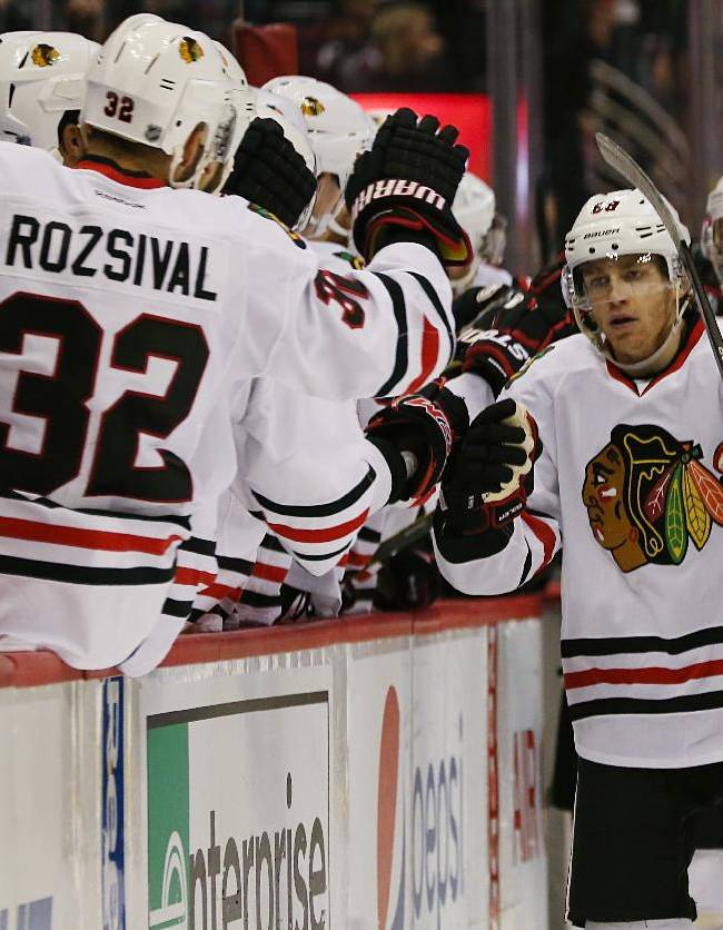 Chicago Blackhawks right wing Patrick Kane, right, is congratulated by teammates after he scored the go-ahead goal against the Colorado Avalanche in the third period of the Blackhawks' 3-2 victory in an NHL hockey game in Denver on Wednesday, Nov. 26, 2014