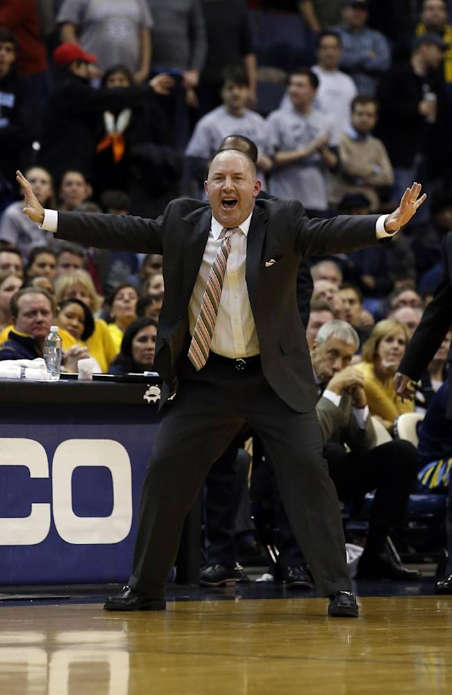 Marquette head coach Buzz Williams directs his team during the second half of an NCAA college basketball game against Georgetown, Monday, Jan. 20, 2014, in Washington. Marquette won 80-72 in overtime
