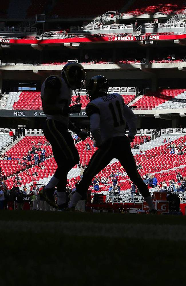 St. Louis Rams' Isaiah Pead, left, and Tavon Austin talk on the field prior to an NFL football game against the Arizona Cardinals, Sunday, Dec. 8, 2013, in Glendale, Ariz