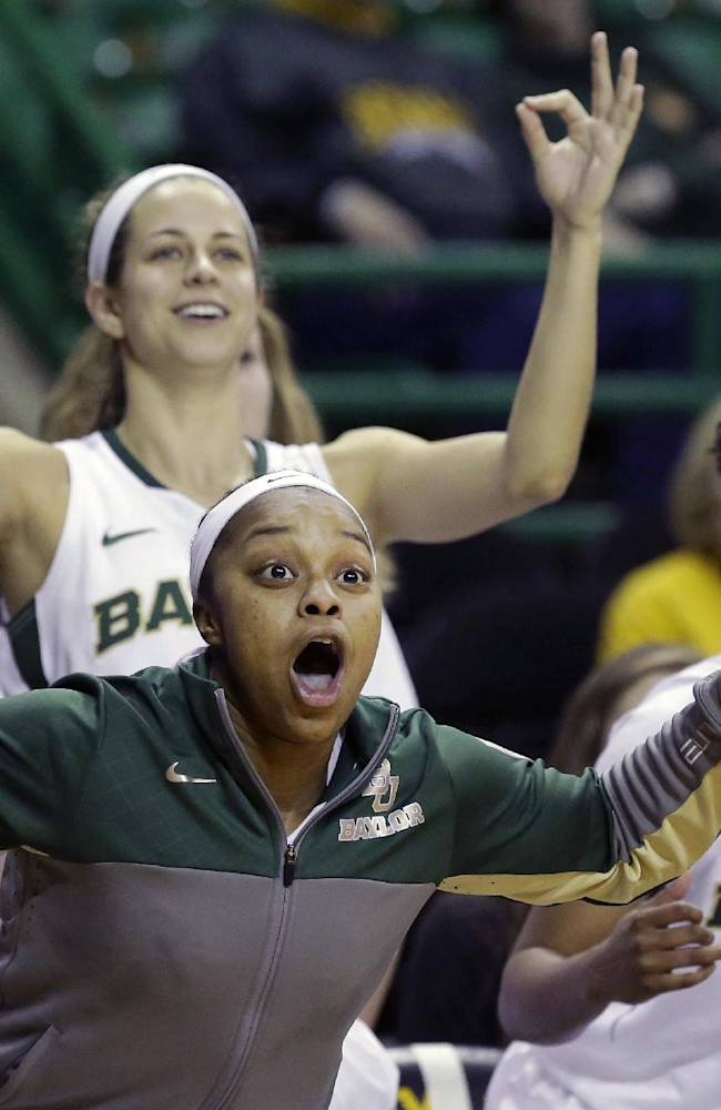 Baylor guard Odyssey Sims, front, celebrates on the bench with teammates Makenzie Robertson, second from right, and Niya Johnson (2) during the second half of an NCAA college basketball game against TCU, Saturday, Jan. 11, 2014, in Waco, Texas. Baylor won 80-46