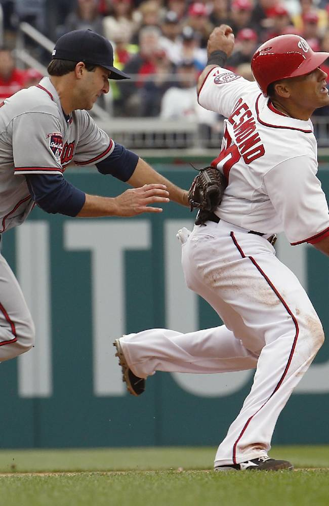 Helped by overturned homer, Braves edge Nats 2-1