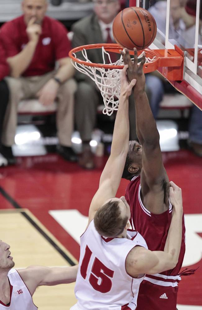 Indiana's Jeremy Hollowell, right, shoots against Wisconsin's Sam Dekker (15) during the first half of an NCAA college basketball game, Tuesday, Feb. 25, 2014, in Madison, Wis