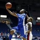 Kentucky guard A'dia Mathies (1) drives for a first half layup past Mississippi forward Tia Faleru (32) during an NCAA college basketball game in Oxford, Miss., Thursday, Feb. 28, 2013. No. 10 Kentucky won 90-65. (AP Photo/Rogelio V. Solis)