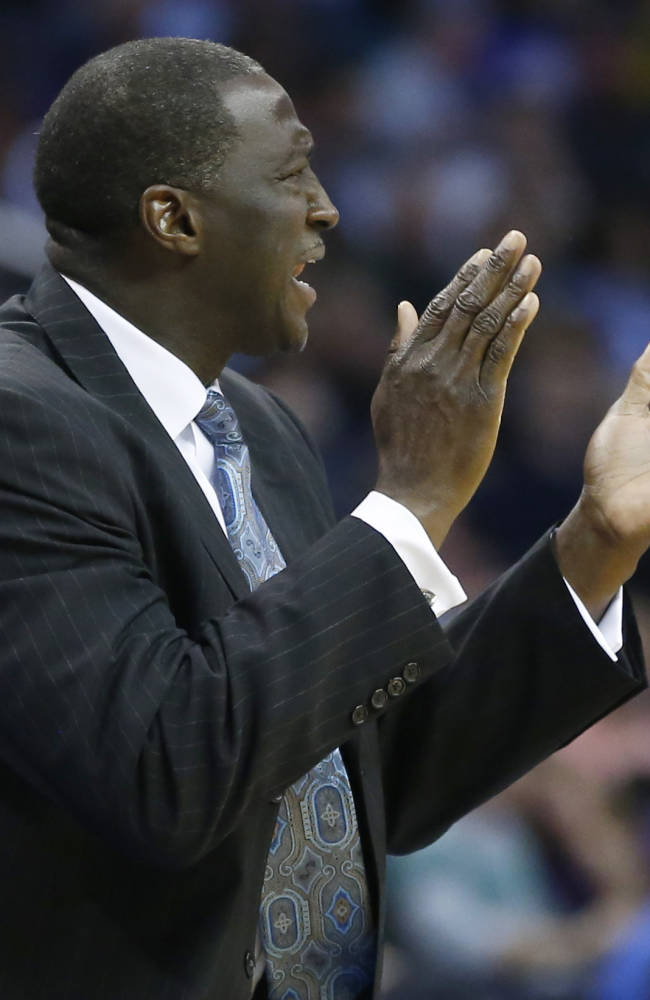 Utah Jazz head coach Tyrone Corbin shouts to his team during the second quarter of a preseason NBA basketball game against the Oklahoma City Thunder in Oklahoma City, Sunday, Oct. 20, 2013