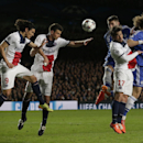Chelsea's Gary Cahill, third right, heads the ball towards goal during the Champions League quarterfinal second leg soccer match between Chelsea and Paris Saint Germain at Stamford Bridge stadium in London, Tuesday, April 8, 2014