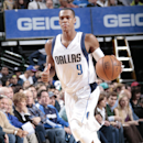 DALLAS, TX - DECEMBER 20: Rajon Rondo #9 of the Dallas Mavericks handles the ball against the San Antonio Spurs on December 20, 2014 at the American Airlines Center in Dallas, Texas. (Photo by Glenn James/NBAE via Getty Images)