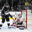 Calgary Flames goalie Joni Ortio makes a save as Los Angeles Kings center Jeff Carter tries to score during the second period of an NHL hockey game, Monday, Jan. 19, 2015, in Los Angeles The Associated Press