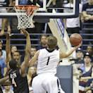 San Diego guard Johnny Dee beats San Diego State guard Dakarai Allen to the basket while driving the lane and scoring during the first half of an NCAA college basketball game Thursday, Dec. 5, 2013, in San Diego. (AP Photo/Lenny Ignelzi)