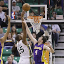 Los Angeles Lakers Ryan Kelly (4) defends against Utah Jazz's Derrick Favors (15) in the first quarter during an NBA basketball game Monday, April 14, 2014, in Salt Lake City, Utah The Associated Press