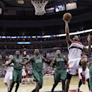 Washington Wizards forward Trevor Ariza (1) shoots in front of Boston Celtics center Joel Anthony (50), forward Jeff Green (8) and center Jared Sullinger (7) during the second half of an NBA basketball game Wednesday, April 2, 2014 in Washington. Ariza ha