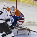 Los Angeles Kings' Jeff Carter (77) scores a goal on Edmonton Oilers goalie Ben Scrivens (30) during the second period of an NHL hockey game in Edmonton, Alberta, Tuesday, March 3, 2015. (AP Photo/The Canadian Press, Jason Franson)