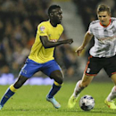 Fulham's Shaun Hutchinson, right, competes for the ball with Derby's Simon Dawkins during the English League Cup soccer match between Fulham and Derby County at Craven Cottage stadium in London, Tuesday, Oct. 28, 2014