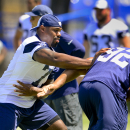 Dallas Cowboys offensive tackle Tyron Smith, left, blocks teammate defensive end Jeremy Mincey (92) during Dallas Cowboy's training camp, Friday, July 25, 2014, in Oxnard, Calif. (AP Photo/Gus Ruelas)