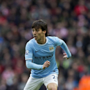 Manchester City's David Silva takes the ball downfield during his team's English Premier League soccer match against Stoke at the Etihad Stadium, Manchester, England, Saturday Feb. 22, 2014