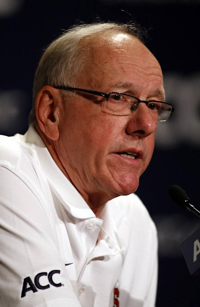 Syracuse coach Jim Boeheim answers a question during a press conference at the Atlantic Coast Conference NCAA college basketball media day in Charlotte, N.C., Wednesday, Oct. 16, 2013