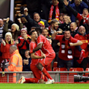 Liverpool's Dejan Lovren, centre left celebrates after scoring against Swansea during the English League Cup soccer match between Liverpool and Swansea at Anfield Stadium, Liverpool, England, Tuesday Oct. 28, 2014