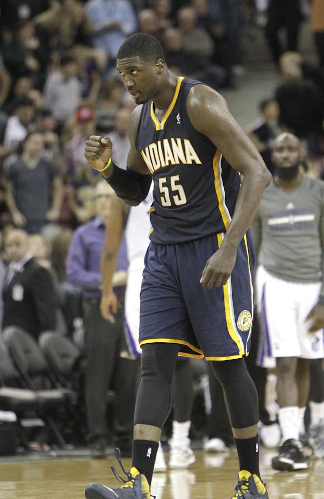 Indiana Pacers center Roy Hibbert pumps his fist in celebration after the Pacers tied the score at the end of regulation play of an NBA basketball game against the Sacramento Kings in Sacramento, Calif., Friday, Jan. 24, 2014. The Pacers won 116-111 in overtime