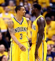 INDIANAPOLIS, IN - MAY 18: George Hill #3 speaks with Lance Stephenson #1 of the Indiana Pacers during Game One of the Eastern Conference Finals of the 2014 NBA Playoffs against the Miami Heat at Bankers Life Fieldhouse on May 18, 2014 in Indianapolis, Indiana. (Photo by Andy Lyons/Getty Images)