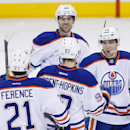 Edmonton Oilers' Andrew Ference (21) Ryan Nugent-Hopkins (93), Justin Schultz (19) and Tyler Pitlick (68) celebrate Nugent-Hopkins' goal against the Winnipeg Jets during third period NHL action in Winnipeg, Manitoba, on Wednesday, Dec. 3, 2014 The Associ