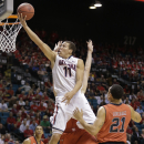 Arizona's Aaron Gordon (11) puts up a shot past Utah's Jordan Loveridge during the first half of an NCAA college basketball game in the quarterfinals of the Pac-12 Conference tournament, Thursday, March 13, 2014, in Las Vegas. (AP Photo/Julie Jacobson)