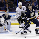 St. Louis Blues' Alex Pietrangelo, right, and Los Angeles Kings' Dustin Brown, center, chase after a loose puck as Blues goalie Jake Allen watches during the first period of an NHL hockey game Tuesday, Dec. 16, 2014, in St. Louis The Associated Press