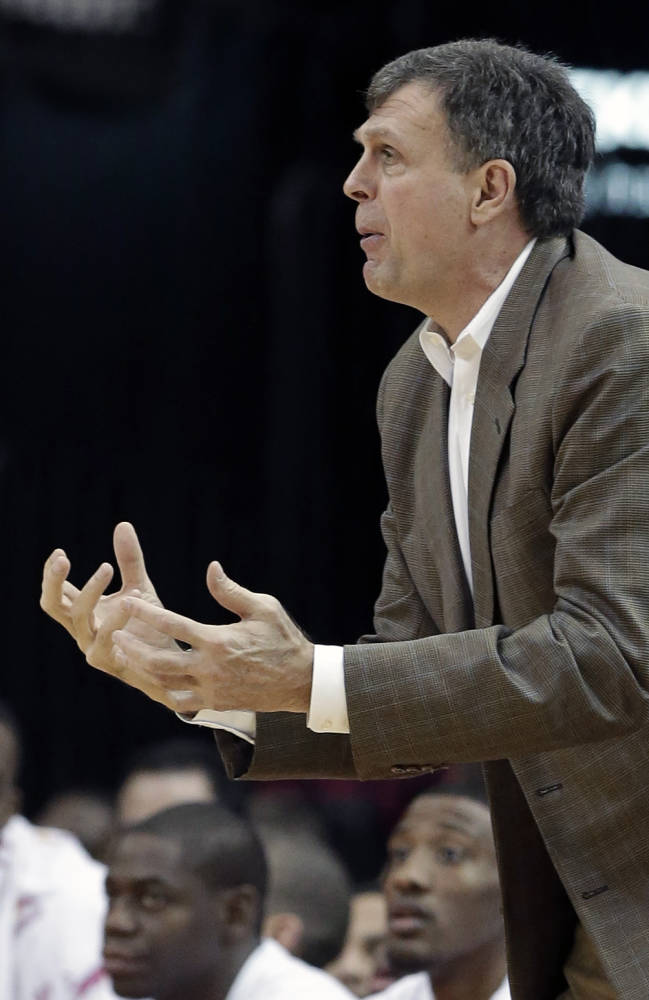 Houston Rockets coach Kevin McHale disputes a call in the first half of an NBA basketball game against the Cleveland Cavaliers Saturday, Feb. 1, 2014, in Houston