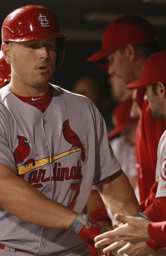 Holliday leads Cards to 11-4 win over Rockies