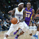 Denver Nuggets guard Ty Lawson, front, looks to pass ball as Los Angeles Lakers guard Jodie Meeks covers in the fourth quarter of the Nuggets' 134-126 victory in an NBA basketball game in Denver on Friday, March 7, 2014 The Associated Press