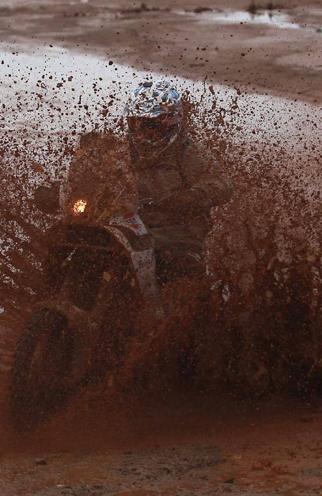 Honda rider Toomas Triisa of Estonia races during the seventh stage of the Dakar Rally between the cities of Salta, Argentina and Uyuni, Bolivia, Sunday, Jan. 12, 2014