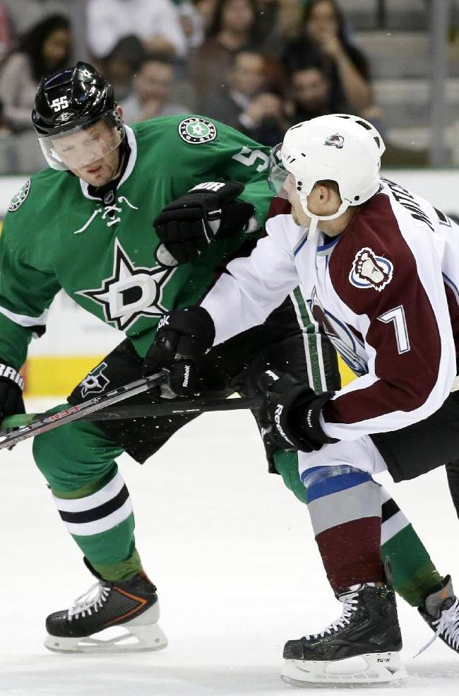 Dallas Stars' Sergei Gonchar (55), of Russia, and Colorado Avalanche's John Mitchell (7) avoid a collision while competing for a loose puck in the first period of an NHL hockey game, Friday, Nov. 1, 2013, in Dallas