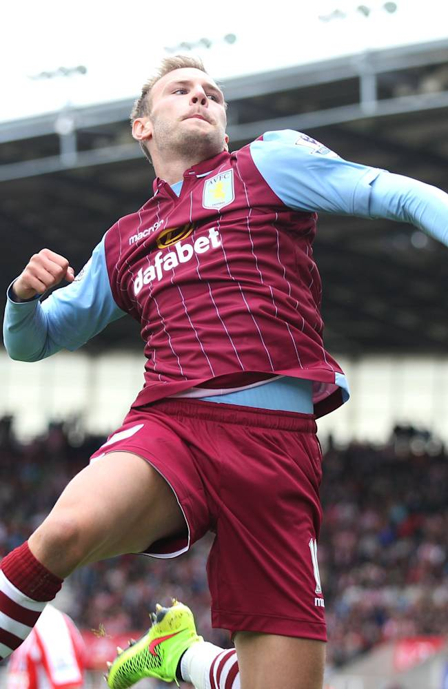 Aston Villa's Andreas Weimann celebrates scoring his side's first goal of the game during the English Premier League soccer match against Stoke City at The Britannia Stadium, Stoke, England, Saturday, Aug. 16, 2014