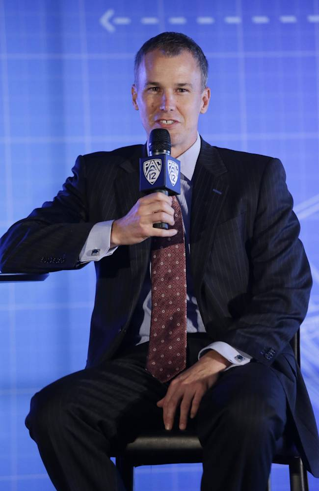 Southern California head coach Andy Enfield answers questions during the Pac-12 NCAA college basketball media day, Thursday, Oct. 17, 2013, in San Francisco