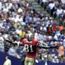 FILE - In this Sept. 24, 2000, file photo, San Francisco 49ers' Terrell Owens celebrates his second quarater touchdown against the Dallas Cowboys from the center of the field in Irving, Texas. Celebrations that used to be part of the game are under increased scrutiny and, though the league rulebook has some very specific examples of what constitutes a penalty, the gray area is as wide as ever. (AP Photo/Vern Steinman, File)