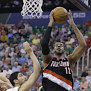 Portland Trail Blazers' LaMarcus Aldridge (12) goes to the basket as Utah Jazz's Enes Kanter (0) defends in the first quarter during an NBA basketball game on Friday, April 11, 2014, in Salt Lake City The Associated Press