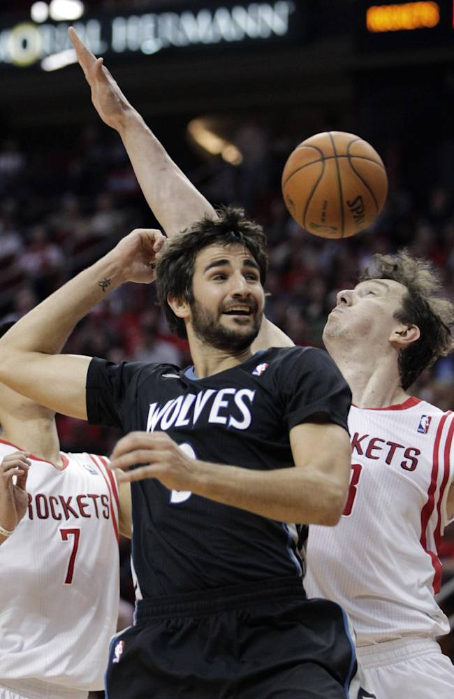Minnesota Timberwolves guard Ricky Rubio, left, loses the ball as Houston Rockets center Omer Asik defends during the first quarter of an NBA basketball game, Tuesday, March 20, 2014, in Houston. The Rockets defeated the Timberwolves 129-106