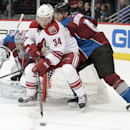 Phoenix Coyotes center Kyle Chipchura (24) backs toward the net as Colorado Avalanche defenseman Erik Johnson (6) defends with Avalanche goalie Semyon Varlamov, of Russia, (1) during the first period of an NHL hockey game in Denver on Tuesday, Dec. 10, 2